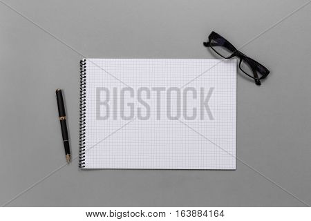 Display Flat Lay Of Business Office Equipment, Grid Book, Fountain Pen, Glasses Top View With Copy S