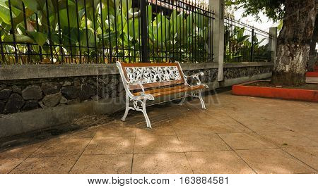 A white bench made from wood and metal at Lawang Sewu photo taken in Semarang Indonesia java