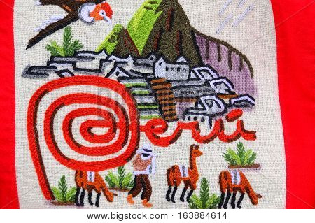 OLLANTAYTAMBO PERU - JANUARY 18: Detail of textile embroidery at the street market on January 18 2015 in Ollantaytambo Peru. Ollantaytambo was the royal estate of Emperor Pachacuti who conquered the region.