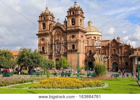 CUSCO PERU - JANUARY 20: Iglesia de la Compania de Jesus on Plaza de Armas on January 20 2015 in Cusco Peru. In 1983 Cusco was declared a World Heritage Site by UNESCO