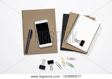 Office Desk Concept Notepad, Diary, Stapler, Pens, Blank Smart Phone And Office Supplies