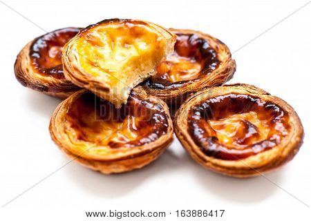 Dessert egg tart sweet custard pie isolated on white background. Group of Typical portuguese dessert