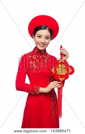 Portrait of a beautiful Asian woman on traditional festival costume Ao Dai. Tet holiday. Lunar New Year.