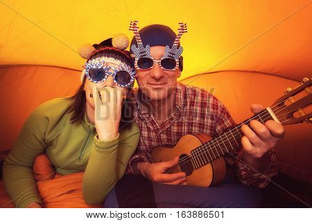 Man With Woman In The Funny Glasses, Playing Ukulele