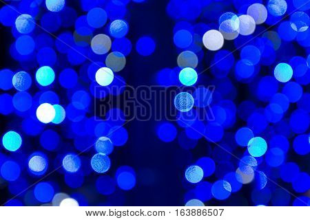 Festive evening bokeh in lapis blue tones.