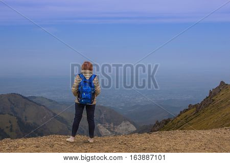 Sport Woman Are Standing At Talgar Pass And Looking On The City, Tien Shan Mountains Near Shymbulak