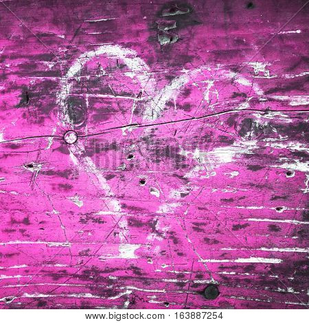 White painted grunge heart on the pink wood background. Romantic postcard template illustration.