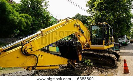 An excavator in the middle of the road photo taken in Semarang Indonesia java