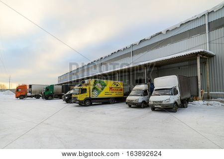 Moscow, Russia - December 13, 2016: Warehouse transport and logistics company. Trucks are on the loading at the warehouse. Freight transport.