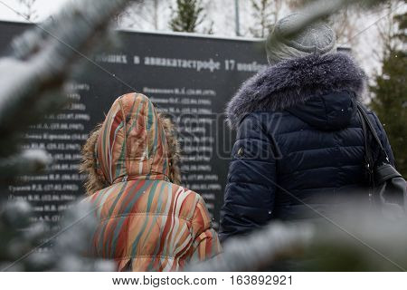 Woman and little girl visiting a the monument was broken in a plane crash, telephoto