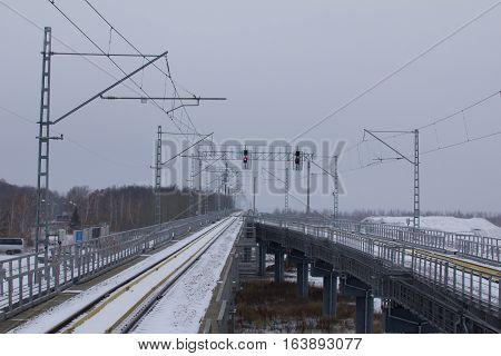 railroad tracks of airport train at cloudy day, wide angle