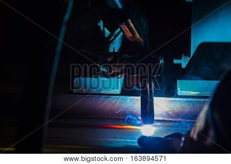 Welding robots movement in a car factory welding robot welding splashes brews argon