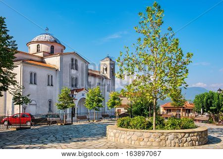 Town square and Church of Sts. Peter and Paul in village of Kastraki. Meteora Greece
