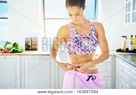 Sportive Woman Holding Tape-measure Round Her Waist