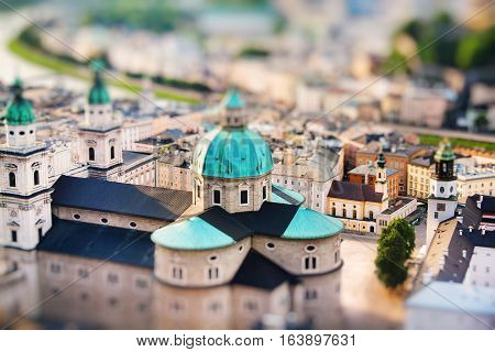 View of Salzburger Dom and the city in the evening Salzburg Austria. Miniature tilt shift lens effect.