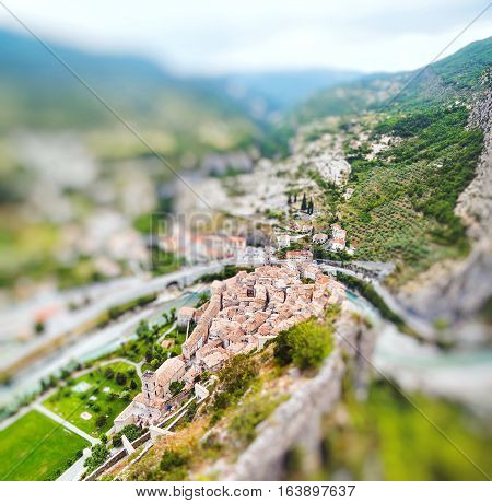 View on town Entrevaux France Europe. Miniature tilt shift lens effect.
