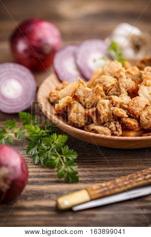 Homemade pork crackling on rustic wooden background