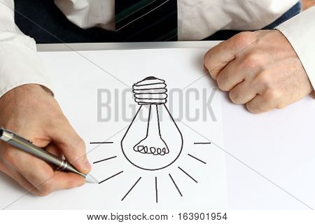 man is finding a new idea on a desk