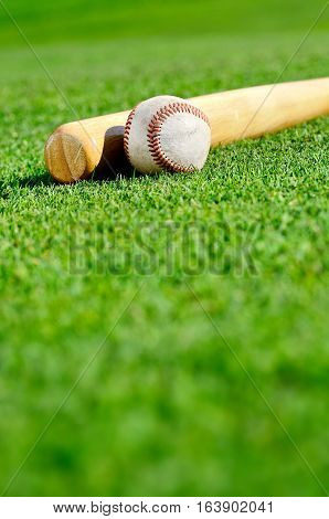 Baseball bat and ball on the field