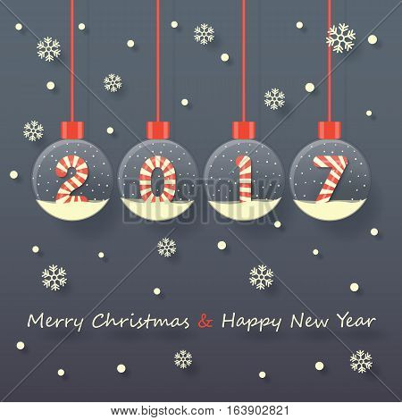 year 2017 sign in red and white Christmas sweet style in snow globe hanging on dark background with snow and snowflakes.