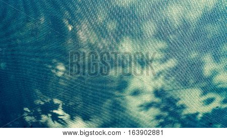 Close Up Of A Blue Canopy Fabric Under The Sun