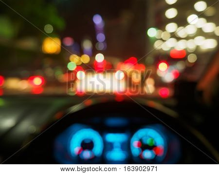 abstract blurred traffic jam at after work time during night view from inside a car