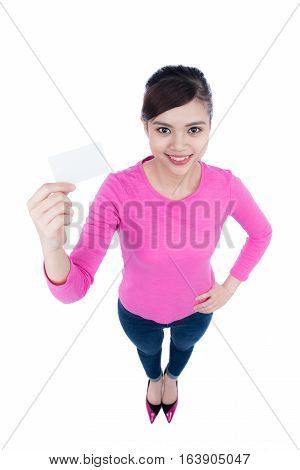 Fun and laughing beautiful female person with blank business card in hand. High angle view