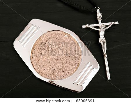 cross and ash - symbols of Ash Wednesday