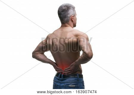 Middle aged man with back pain muscular male body studio isolated shot on white background with red dot