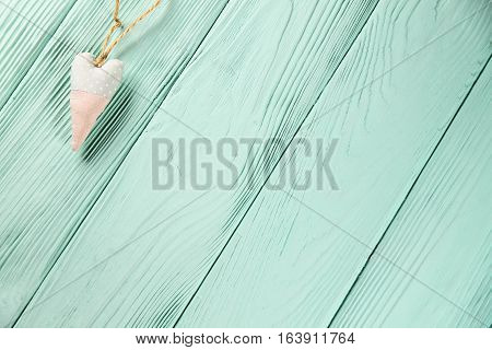 heart with polka dots on a wooden background