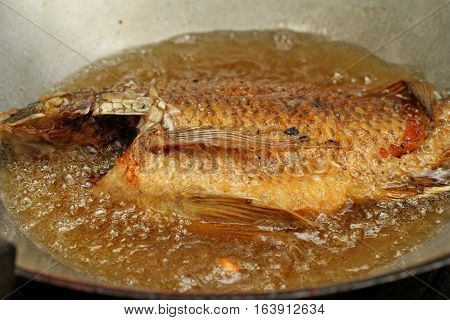 Cooking Of Deep Fried Nile Tiapia Fish.