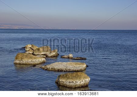 Beauty day view of sea rocks with algae