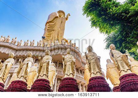 Buddha statues with large gold buddha and nature