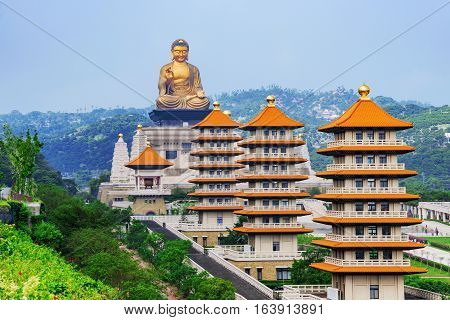 View of Pagodas and Buddha statue with scenic mountain surroundings in Fo Guang Shan