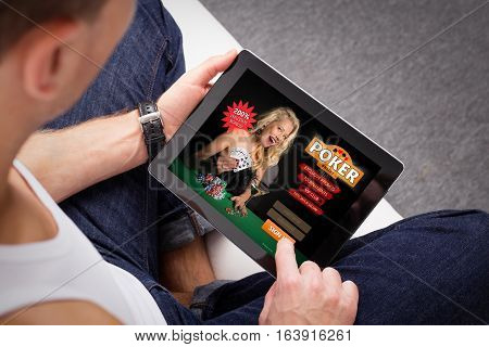 Man playing online  poker on tablet computer