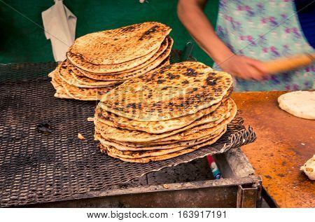 Fresh grilled flat bread at the Feria de Mataderos