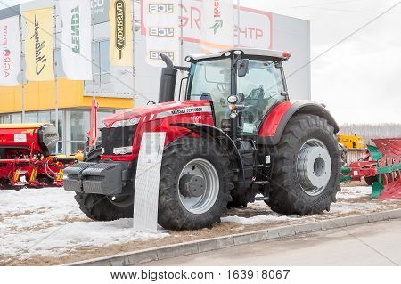 Tyumen, Russia - April 04. 2014: IV Tyumen specialized exhibition Agricultural Machinery and Equipment. Tractor demonstration on platform open-air
