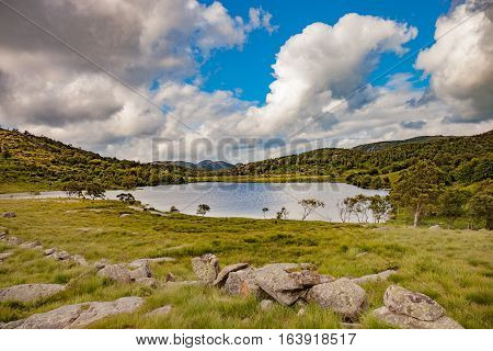 Smal lake in landscape of Norway .