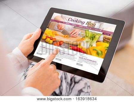 Cooking blog on tablet computer with new content