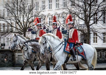 Copenhagen, Denmark - January 04, 2017: Trumpeters of the Guard Hussar Regiment which escorts Queen Margrethe in a 24-carat golden coach from Christiansborg Palace to Amalienborg Palace