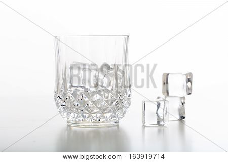 Crystal Glass Of Whiskey And Ice On White Background
