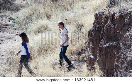 SIERRA VISTA, ARIZONA, DECEMBER 20. The Murray Springs Clovis Site on December 20, 2016, east of Sierra Vista, Arizona. A pair of hikers at the Murray Springs Clovis Paleoindian Site.