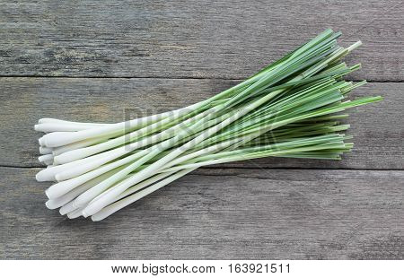 Fresh lemongrass (citronella) on wooden background - Spice for health.