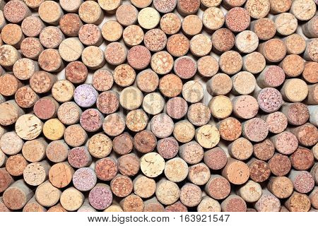 Background of used wine corks. Wall of many different wine corks.