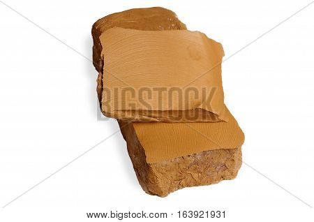 Brick Of Clay On White