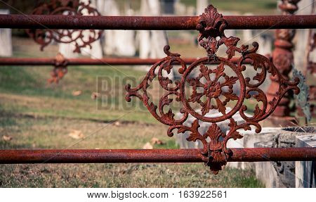 Rusted metal design at a graveyard in Maine