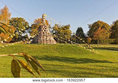 Hemel Hempstead England - November 2016: Amaravati Buddhist Monstary. Buddhist stupa on a hill decorated with Buddhist prayer flags.