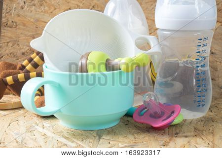 Feeding baby accessories - bottles teats on wood table