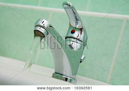 chrome water faucet in bathroom