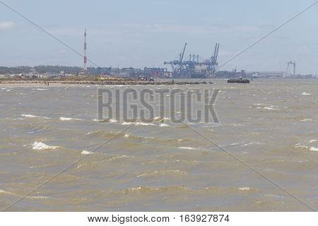 Channel Connecting Lagoa Dos Patos To The Ocean With Rio Grande Port In Background